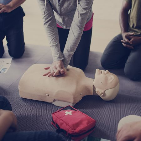 CPR mannequin on the floor for First Aid